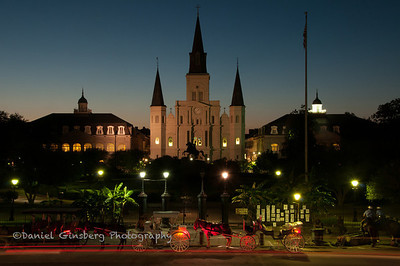 Horses and carriages in front of Jackson Square, St Louis Cathedral in the background.