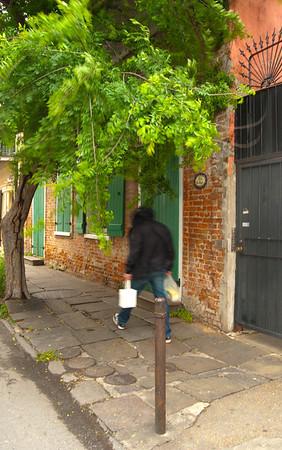 New Orleans Sidewalk with Hooded Walker