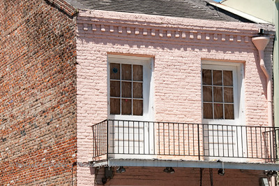 Balcony on brink painted pink in New Orleans.