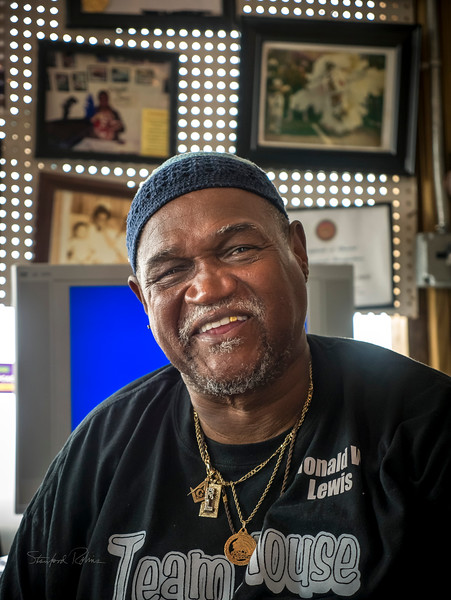 """This is Ronald W. Lewis, proprietor  of the House of Dance and Feathers museum, located in the Lower Ninth Ward, and devoted to the history of New Orleans' many traditions. I wanted to learn more about the Mard Gras Indians, so my sister Shair and I visited the museum.  Mr. Lewis was the 2008 King of the Krewe du Vieux a satirical """"alternative"""" Mardi Gras. He is an Honorary Member of the Krewe du Jieux, """"a free-spirited parade organization dedicated to deflating the stereotypes that have been historically aimed at the Jewish people."""" He knows as many Yiddish words and expressions as this second generation America Jew, and great deal about American Jewish culture. He says the one thing about """"our culture"""" (his words) that he can't quite get into is gefilte fish. Well, it definitely is an acquired taste. Being from Minnesota, I suppose if I were to decide to become a Scandinavian (work with me here), I might be slow to love lutefisk."""