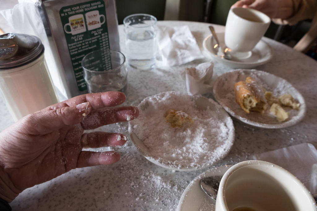 Cafe du Monde, open 24 hours since the 1860s. The world's supply of powdered sugar is delivered here every day. Don't tell my Internist
