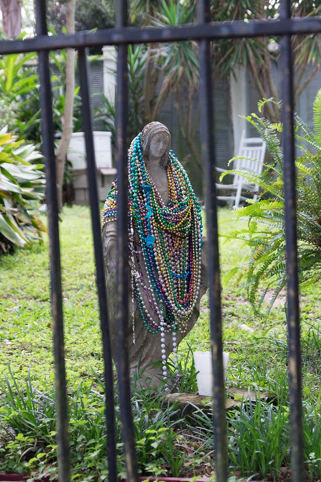 And a religious statue draped in beads. Of course