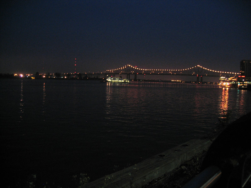 The mighty Mississippi at night. Notice the ferry boat. I think this is the same one used on Dejevue