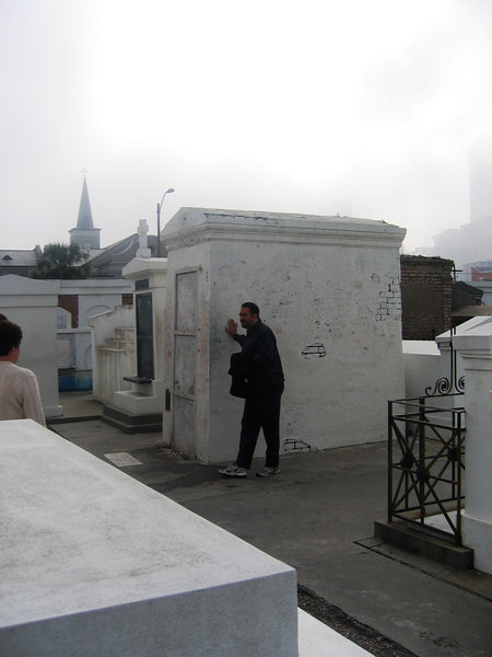 Grave of Mary Laveau the Voodoo Queen 1794-1881 and 2 close fiends perhaps. They stack them up.