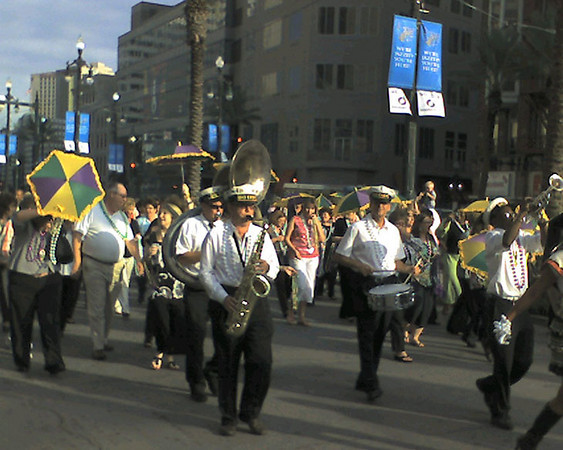 For some reason, there was a parade heading north on Canal Street late in the afternoon on Monday. They were even tossing out beads.<br /> <br /> This was captured with my little cell phone camera.