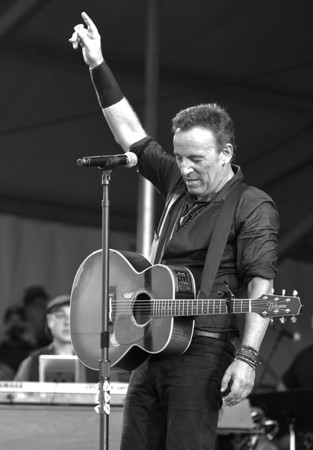 "Bruce Springsteen~ Classic pose of the ""Boss"",  He showed everyone in New Orleans, how he received that name.  Excellent Concert."