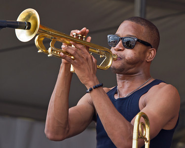 Trombone Shorty~ New Orleans Jazz Festival 2012 ~ Massive Crowd in his sunglasses enjoying the pre-Bruce warm up!  Tombone Shorty does it All, very talented Musician!