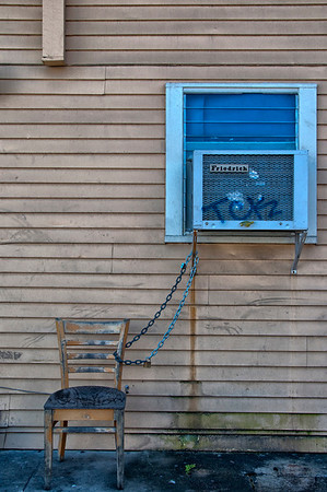 New Orleans chair locked to air conditioner