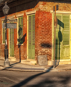 New Orleans corner with lamp and stop sign shadows.
