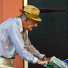 older gentleman pushing grocery cart in rain near Jackson Square New Orleans