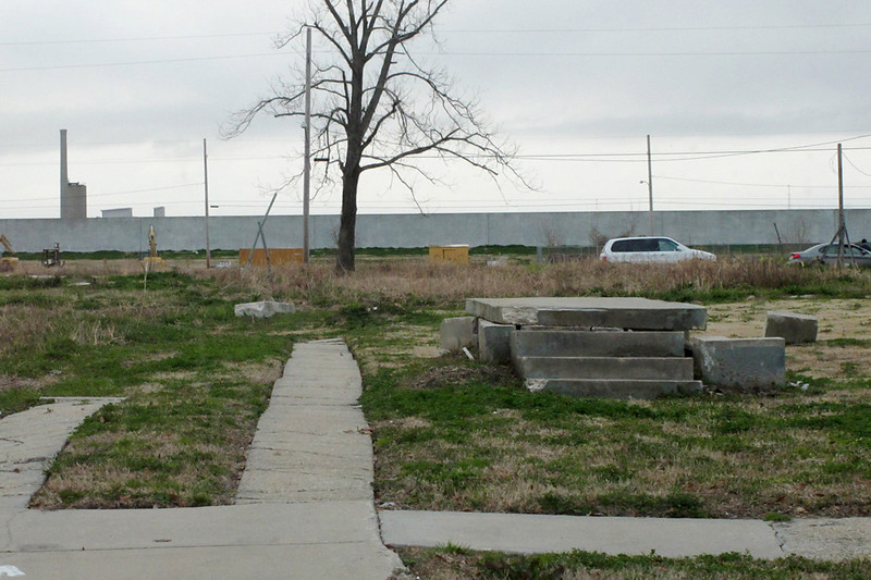 There are a few eerie doorsteps to nowhere...ghosts of former houses. That simple-looking white wall in the distance is the levee.