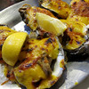 Oysters Bienville, made with butter, wine, diced shrimp and mushroom, cheddar and Parmesan cheese. Really delicious.