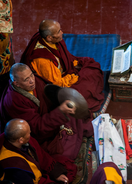 Tibetan monks doing puja.  The cymbal is called rolmo in Tibetan and is used to accentuate sections of the puja.