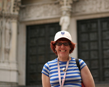 Mary Ellen in front of doors to Cathedral of St. John the Divine.