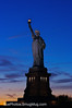 North America, USA, New York, New York City.  The Statue of Liberty at sunset