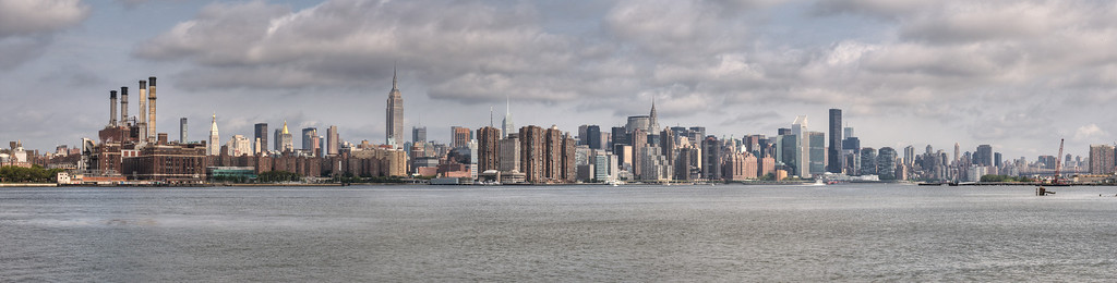 New York City from across East River in Williamsburg. Taken with Nikon D90 and Nikkor 24-70-mm  lens. Processed with Photomatix Pro 4.1 and Photoshop CS5.  Panorama 10570 x 2680 pixels.