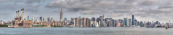 New York City from across East River in Williamsburg.   Taken with Nikon D90 and Nikkor 24-70-mm  lens. Processed with Photomatix Pro 4.1 and Photoshop CS5.  Panorama 13460 x 2760 pixels.