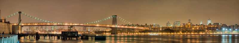 Williamsburg Bridge across East River, NY. Taken with Nikon D90 and Nikkor 24-70-mm  lens. Processed with Photomatix Pro 4.1 and Photoshop CS5.  Panorama 15000 x 2735 pixels.