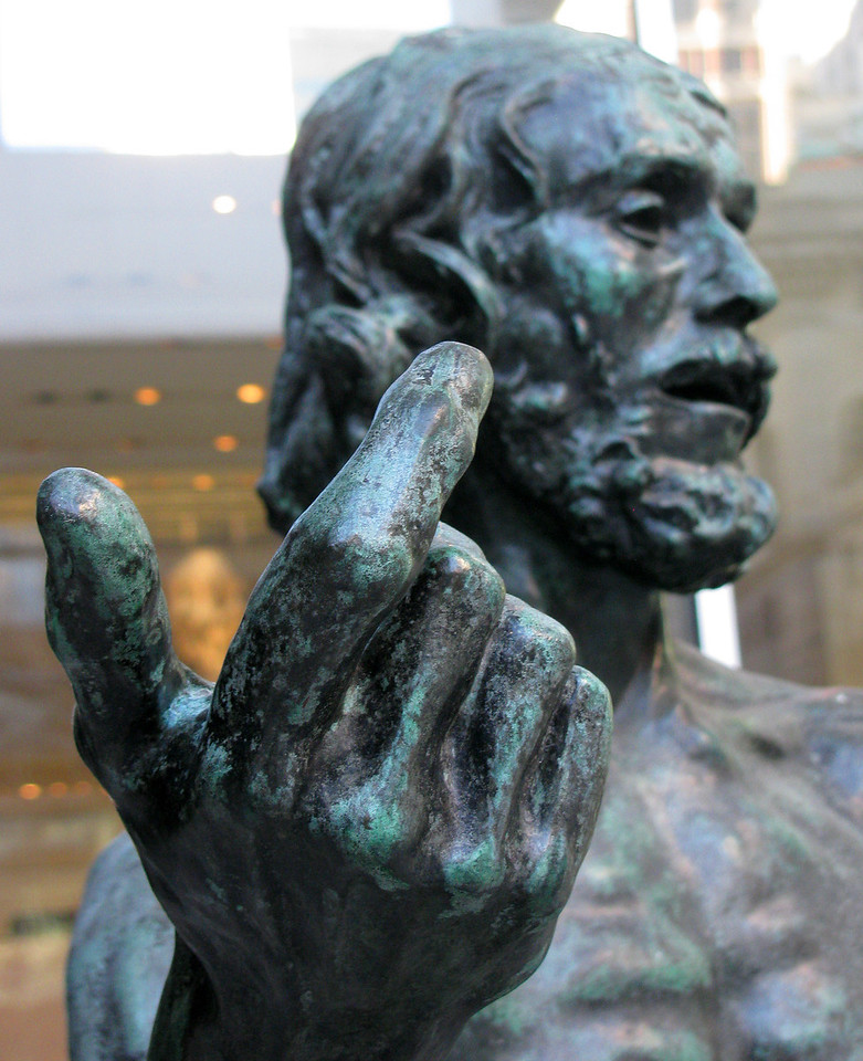 Statue at MoMA gestures to visitors.