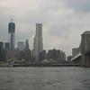 The Brooklyn Bridge and two of the four towers (under construction) of the new World Trade Center.