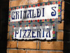 Oven baked pizza under the Brooklyn Bridge.  Very popular tourist spot.  Frank Sinatra photos on the wall.