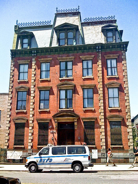 "Former 32nd Precinct Mounted Police Station House, Washington Heights, NYC<br /> <br /> Built in 1871, the former 32nd Precinct Mounted Police Station house at the southwest corner of Amsterdam Avenue  and 152nd Street is a holdout from the days when this area was best known as Carmansville (a name perpetuated by the public playground just across the avenue). The so-called ""trans-Harlem"" area of upper Manhattan was a country district where mounted police were a substantial part of the force. The old precinct house is built in the French Second Empire style, its mansard roof with iron cresting still conspicuous above the relatively low-scale streetscape. The building now belongs to a local church."