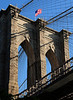 Brooklyn Bridge 3<br /> The low angle and the blue sky makes the bridge look rather magestic.  And... the flag helps.