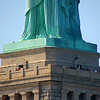 The people give the statue a sense of scale.