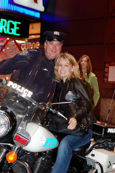 Tricia posing on a NYPD's chopper in Times Square.