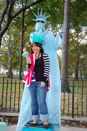 Sam(NOY) posing with a street performer in Battery Park, NY.