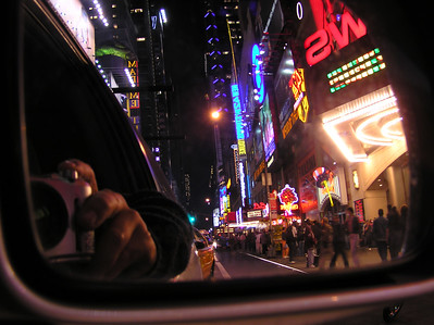 Night view, Manhattan, Times Square in rear view window