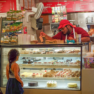 Picking her favorite sweets at Grand Central. I would go for the cheese cake!