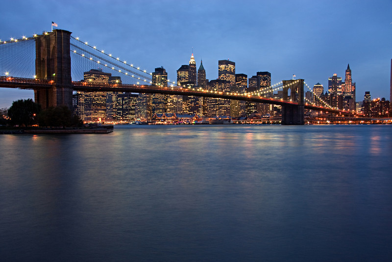 New York City evening skyline with Brooklyn Bridge
