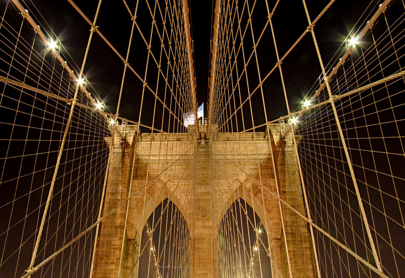 Network and symmetry of Brooklyn Bridge suspension cables