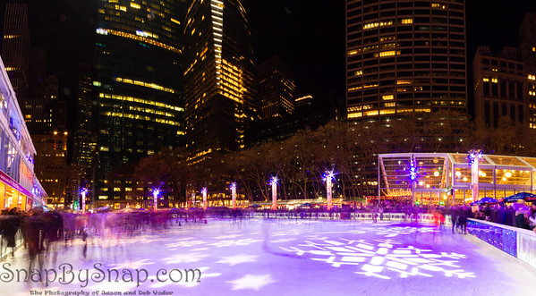 Long exposure panorama of ice skaters on the rink at the Bryant Park Holiday Village