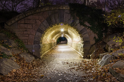 Nighttime image looking through Inscope Arch in New York City's Central Park