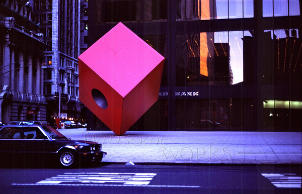 """Red Cube Sculpture"" by Isamu Noguchi in front of 140 Broadway, a building designed by Gordon Bunschaft  (Kocachrome scan, c.1992)"