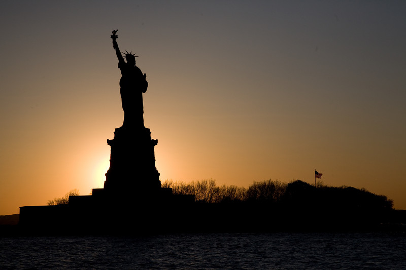 Sun setting behind Liberty Island.
