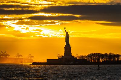 The Statute of Liberty standing in New York harbor