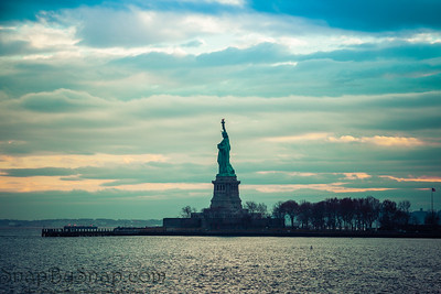 The Statute of Liberty standing in New York harbor