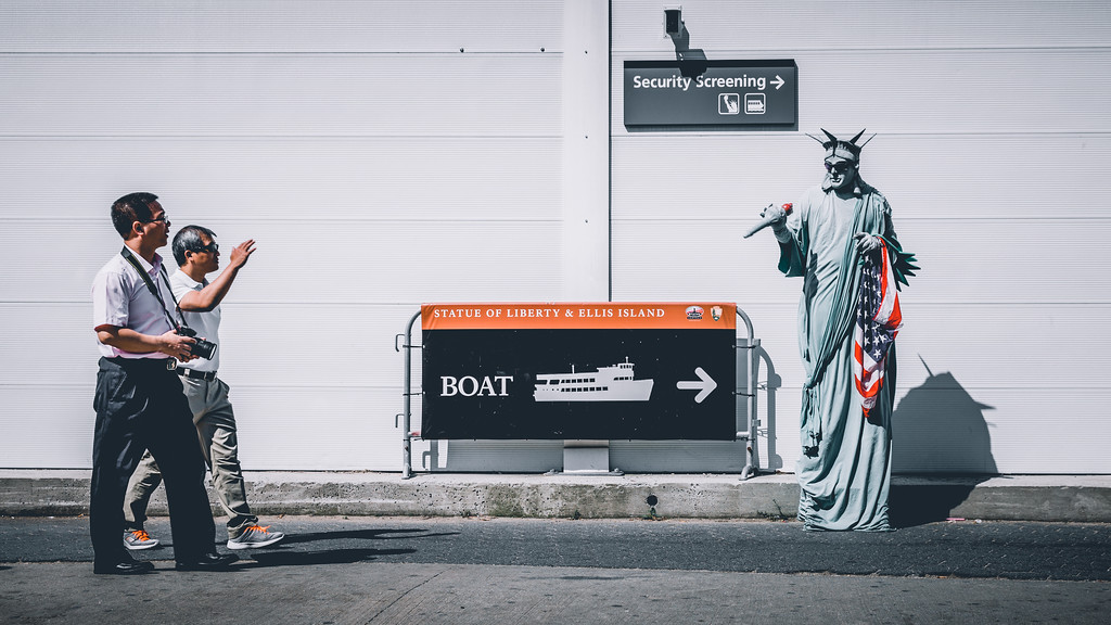 Tourist waving at Lady Liberty