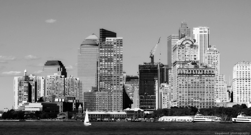 Lower Manhattan skyline from the Staten Island Ferry.  The building site in the middle is the new Freedom Towers at Ground Zero.  This is the spot the Twin Towers used to occupy.