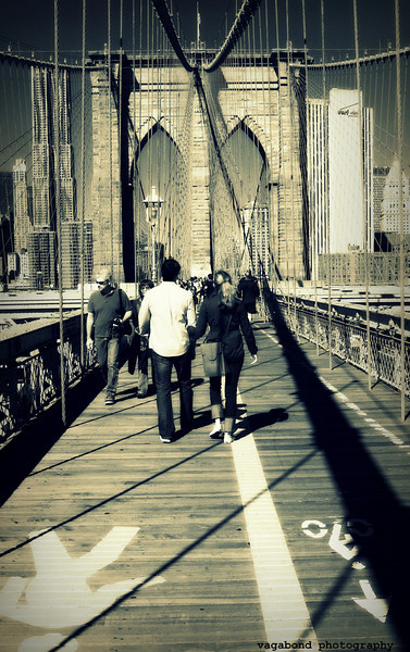 Walking across the Brooklyn Bridge.