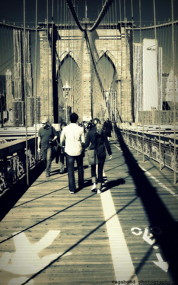 Walking across the Brooklyn Bridge.