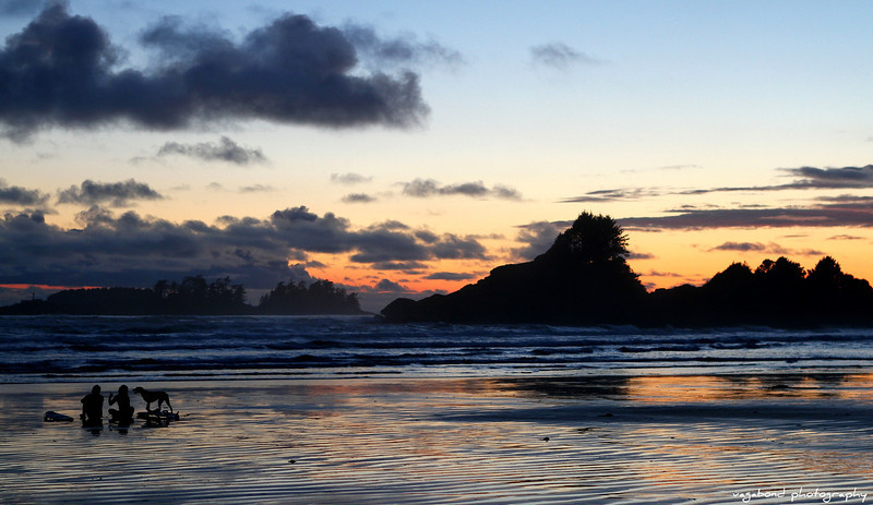 Surfer's at sunset, Long Beach, Tofino