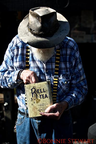 Miner measuring Tea