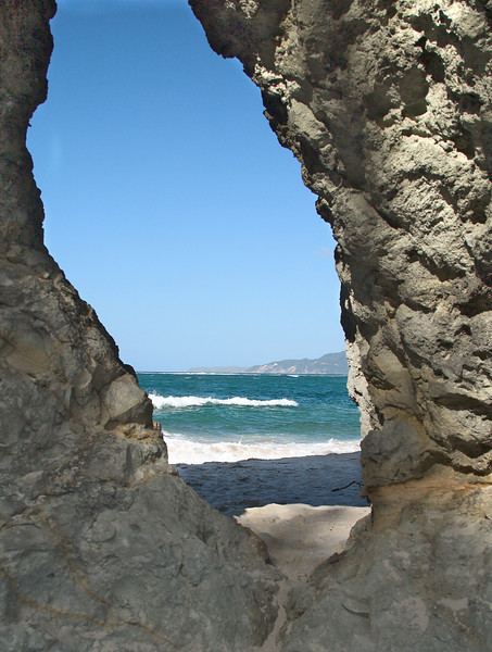 Looking through the arch to rougher waters outside the sheltered area of Opra Bay.