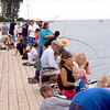 Apparent adult participation in the kids fishing contest.
