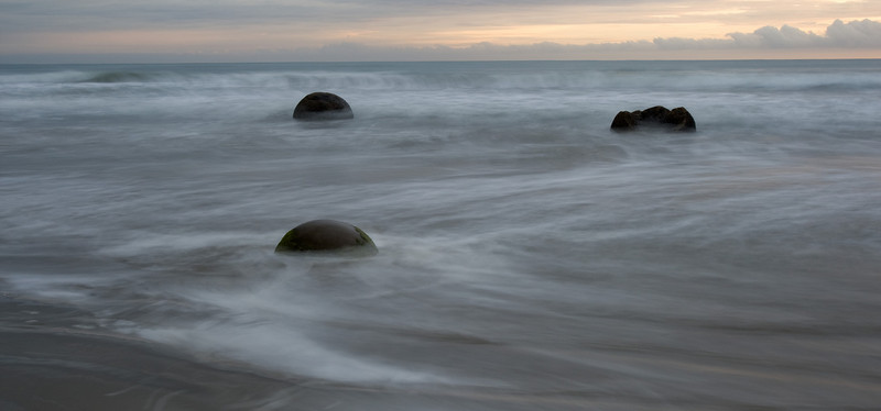 "This is my favorite of the Moeraki Boulders. Its a long exposure and the ""mist"" is just the moving waves."