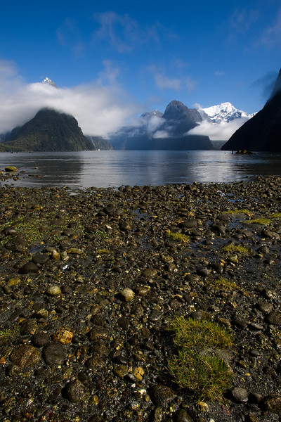 We arrived at dawn in Milford Sound. However, we were completely socked in. After breakfast as we were about to seek other locations, the clouds began to clear. This is what it looked like by the time I made it back to the water's edge.